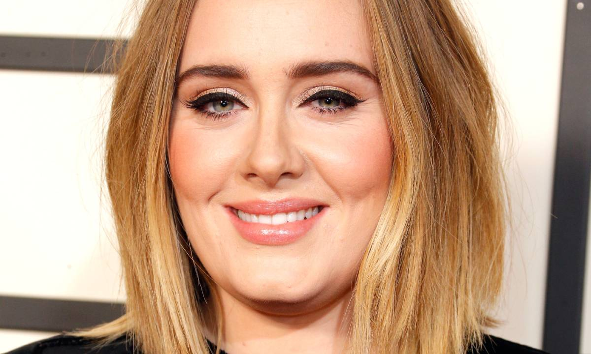 Adele breaks silence on weight loss as she jokes about being half her size
