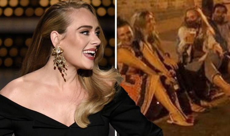 Adele stuns in unseen snap after 7st weight loss as she enjoys pint with pals in London